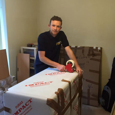 Removals man wrapping for export